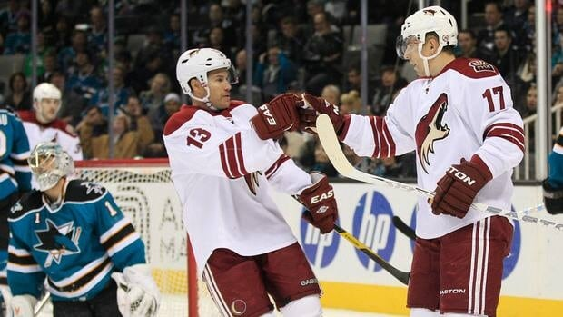 Phoenix Coyotes right wing Radim Vrbata celebrates his goal with teammate left wing Ray Whitney (13) against the San Jose Sharks on Saturday in San Jose.