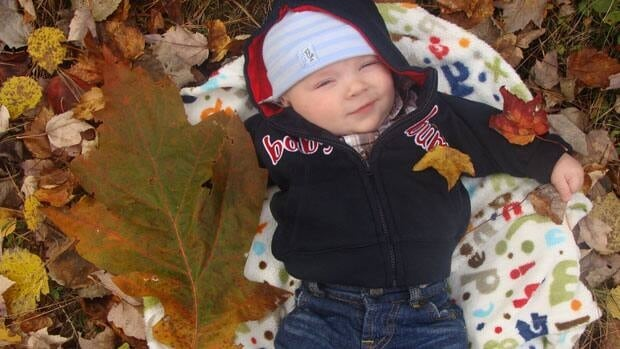 World record oak leaf with Brady Plebon, who was four months old at the time his family found the leaf. Photo courtesy of Gary and Stephanie Plebon