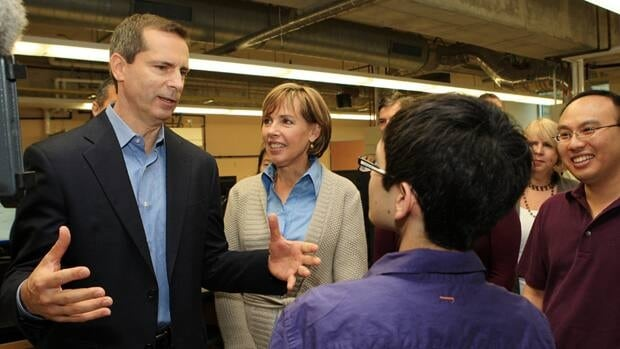 Ontario Liberal Leader Dalton McGuinty and his wife Terri chat with students in the chemistry department at the University of Western Ontario in London on Thursday.