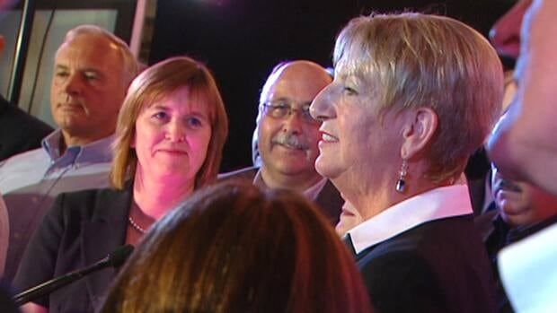 Kathy Dunderdale, flanked by cabinet ministers Joan Burke and Ross Wiseman, spoke Monday night to PC supporters at a campaign rally in St. John's.