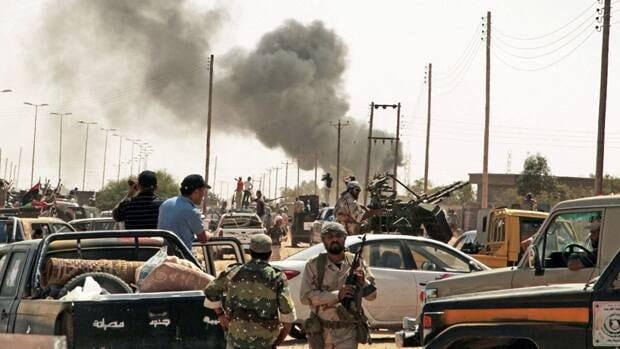 Libyan revolutionary fighters and Gadhafi loyalists battle along the roads of Gadhafi's hometown of Sirte on Sept. 16, 2011.