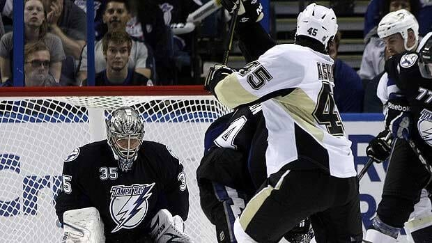 Pittsburgh Penguins right wing Arron Asham takes the shot that would result in the second goal on Tampa Bay Lightning goalie Dwayne Roloson during Game 4 action on Wednesday.