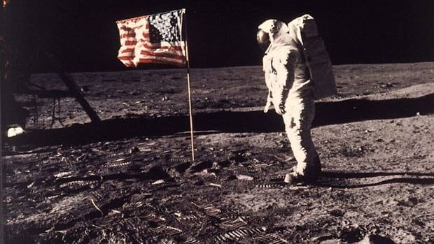This July 20, 1969, file photo shows astronaut Edwin E. (Buzz) Aldrin Jr. standing beside the U.S. flag on the moon during the Apollo 11 mission. According to documents obtained by Reuters, U.S. companies can stake claims to lunar territory through an existing licensing process for space launches.