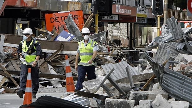 Police officers walk through the central business district in earthquake-damaged Christchurch.
