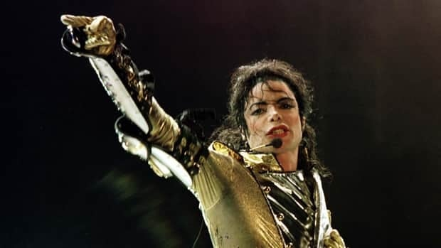 Michael Jackson performs during his HIStory World Tour concert in Vienna on July 2, 1997. The late pop star made $275 million last year.