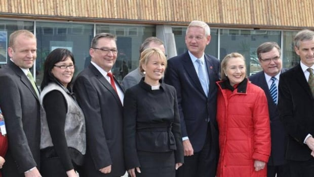 Arctic Council leaders, including Canada's Leona Aglukkaq, second from left, and U.S. Secretary of State Hillary Clinton, third from right, pose for a photograph in Nuuk, Greenland, in 2011. Members of the council are in Yellowknife this week for a meeting, including a Russian delegation.