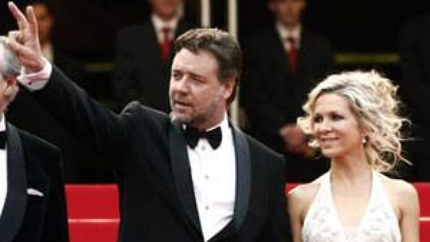 Actor Russell Crowe, left, and Danielle Spencer arrive at the premiere for the film Robin Hood at Cannes, France, in May 2010.