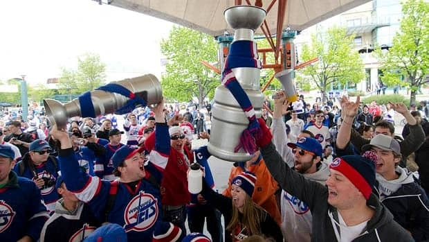 Winnipeg hockey supporters rally at The Forks in Winnipeg earlier this week after the announcement that an NHL team will be returning to the city after 15 years.