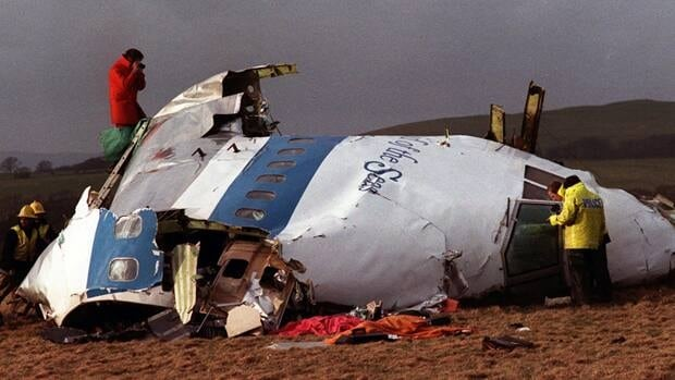 Investigators look at what remains of the flight deck of Pan Am 103 on a field in Lockerbie, Scotland, in 1988. A total of 270 people died when a bomb exploded on the airplane. (Associated Press)