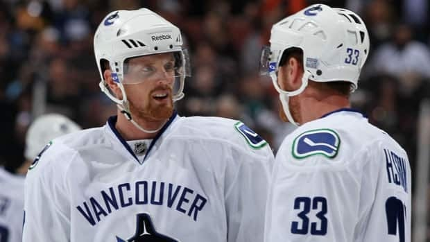 Vancouver's Daniel Sedin, left, hopes to follow his teammate and twin brother, Henrik, right, as the winner of the Hart Memorial Trophy.