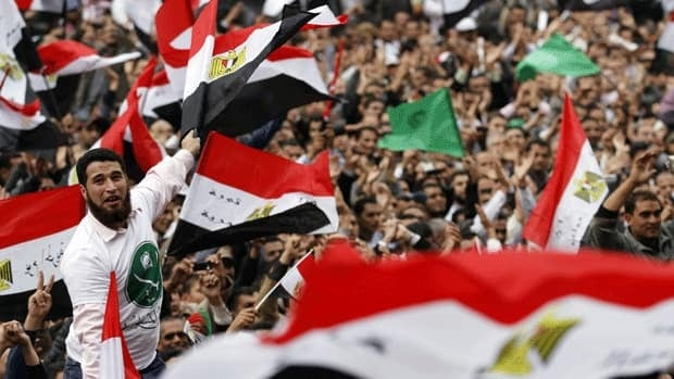 Thousands of Egyptians gather during a demonstration at Tahrir Square in Cairo on Nov. 18, 2011. Tens of thousands of Egyptian protesters have flocked to the square in recent days to pressure the military government to hasten the transfer of power to a civilian democratically elected government.