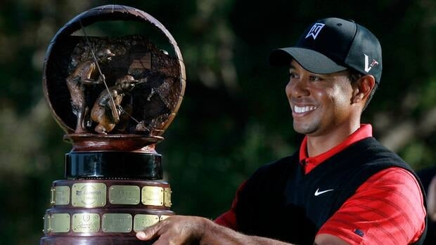 Tiger Woods holds his trophy after winning the Chevron World Challenge golf tournament at Sherwood Country Club on Sunday in Thousand Oaks, Calif.