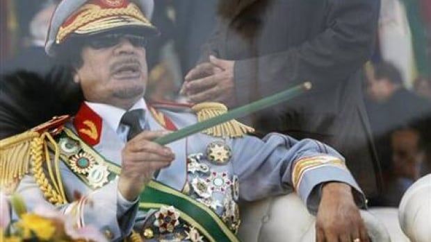 Libyan leader Moammar Gadhafi sits behind a pane of bulletproof glass observing a military parade in Tripoli on Sept. 1, 2009, the 40th anniversary of his rise to power.