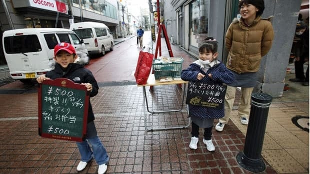 While Japanese officials warned the public Saturday not to expect a solution soon to problems at the Fukushima Daiichi nuclear plant, Sendai restaurant owner Miyuki Sawada and children Taiyo, left, and Maria were taking an upbeat approach to attracting customers in for lunch.