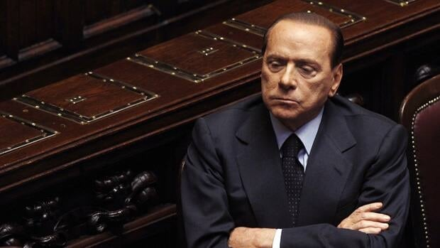 Prime Minister Silvio Berlusconi won a crucial budget vote after a majority of legislators in parliament refused to vote.