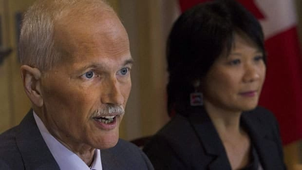 NDP Leader Jack Layton speaks to the media as his wife Olivia Chow looks on at a news conference in Toronto on Monday,where he announced has been diagnosed with another form of cancer and is taking a temporary leave of absence to fight it.
