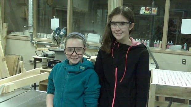 Eve MacKinnon (left) and Chloe Jardine in the industrial arts room at the old high school.