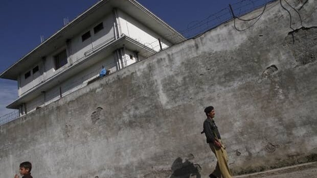 A police officer walks in front of the compound where al-Qaeda leader Osama bin Laden was killed in Abbottabad on May 3.