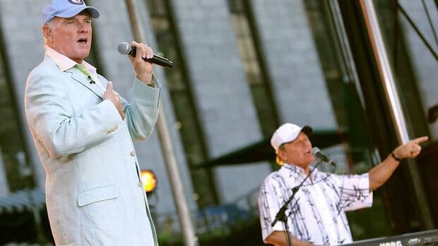 Mike Love, left, and Bruce Johnston of The Beach Boys perform in New York in 2006. After working with his cousin Brian Wilson recently, fellow founding band member Love agreed to a reunion.