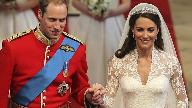 Prince William and his wife, Kate, Duchess of Cambridge, walk up the aisle after their wedding ceremony in Westminster Abbey on Friday. William will also be known as Earl of Strathearn and Baron Carrickfergus and Kate as Countess of Strathearn and Baroness Carrickfergus.