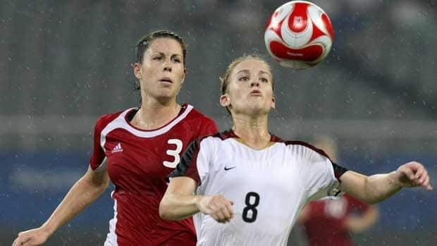Canadian defender Emily Zurrer, left, made her national team debut in 2004.