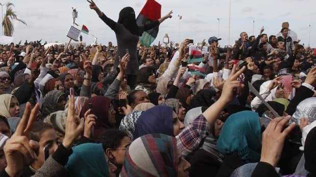 Protesters chant anti-government slogans in a square in Benghazi city.