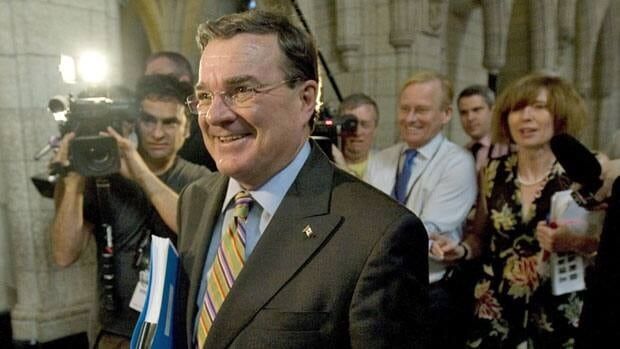 Reporters follow Finance Minister Jim Flaherty as he heads to a Conservative Party caucus meeting June 1. Flaherty requested a briefing in 2010 about the mid-90s deficit-busting cuts made by the then-Liberal government.