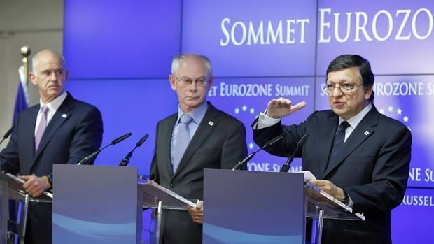 From left, Greek Prime Minister George Papandreou, European Council President Herman Van Rompuy and European Commission President Jose Manuel Barroso participate in a media conference after the EU leaders' summit Thursday.