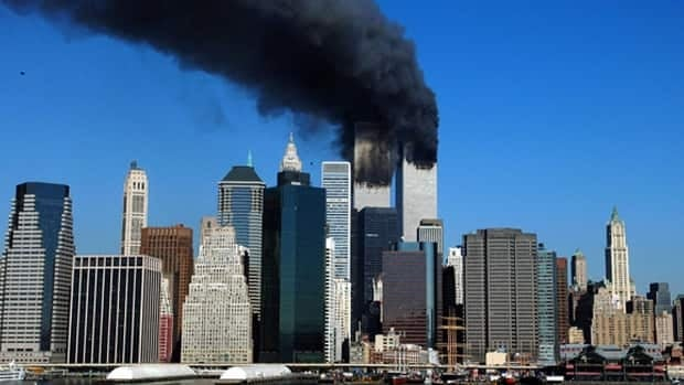 The twin towers of the World Trade Center billow smoke after hijacked airliners crashed into them on Sept. 11, 2001.