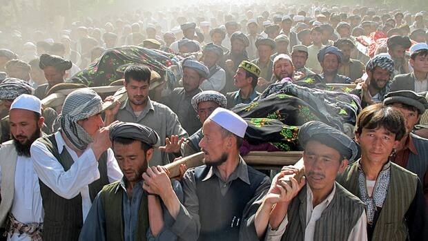 Afghans on Tuesday carry the bodies of people killed overnight after a raid by NATO and Afghan forces.
