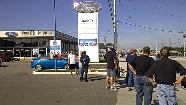 A picket in front of the Rose City Ford dealership on Tecumseh Road East blocked traffic briefly on Wednesday morning, as employees, who have been working without a contract since last July, walked off the job.