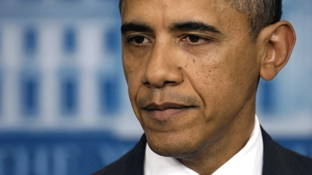 U.S. President Barack Obama says he will veto any effort to undo automatic spending cuts that would kick in in 2013.