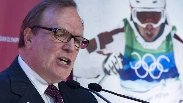 Canadian Olympic Committee president Marcel Aubut, seen here at a news conference in Montreal on Thursday, announced Saturday that coaches would get cash incentives for athletes' medal-winning performances.