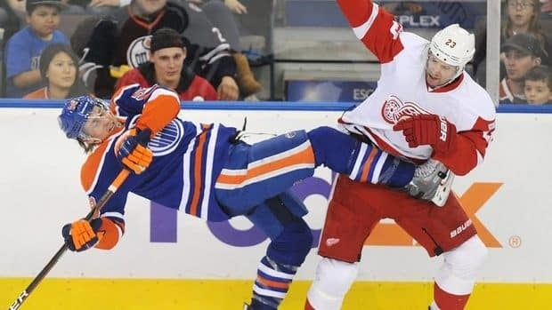 Detroit Red Wings' Brad Stuart, right, checks Edmonton Oilers' Jeff Petry during the second period.