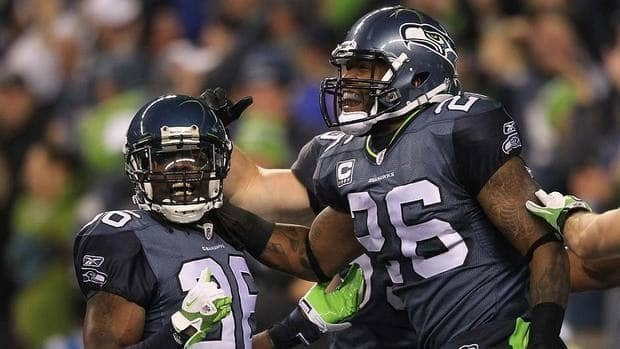 Michael Robinson, right, of the Seattle Seahawks celebrates with Ron Parker, left, after scoring a touchdown on a blocked punt against the St. Louis Rams Monday night. The Seahawks won 30-13.