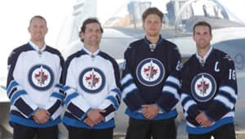 timeless design 39810 9cd87 Winnipeg Jets unveil new jerseys | CBC News