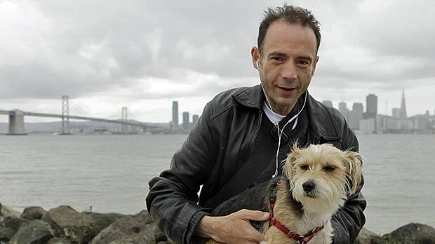 Timothy Ray Brown, the only man ever known to have been apparently cured from AIDS, with his dog, Jack, on Treasure Island in San Francisco on May 16.