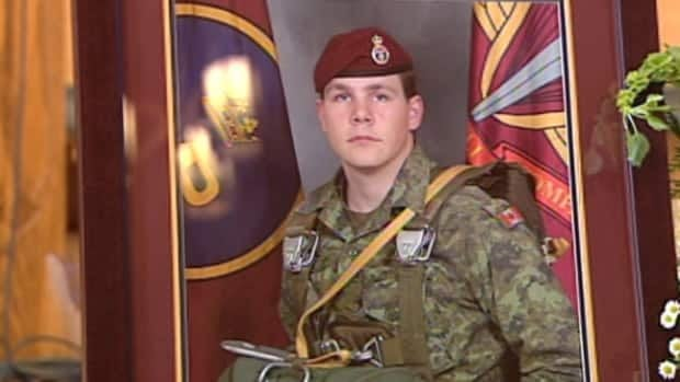 A picture of Master Cpl. Byron Greff, killed by a suicide bomb in Afghanistan Oct. 29, sits at the front of a church in Lacombe, Alta., prior to a public memorial.