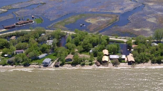 Lakefront properties at Twin Lakes Beach are surrounded by water forced inland last week by gusting winds.