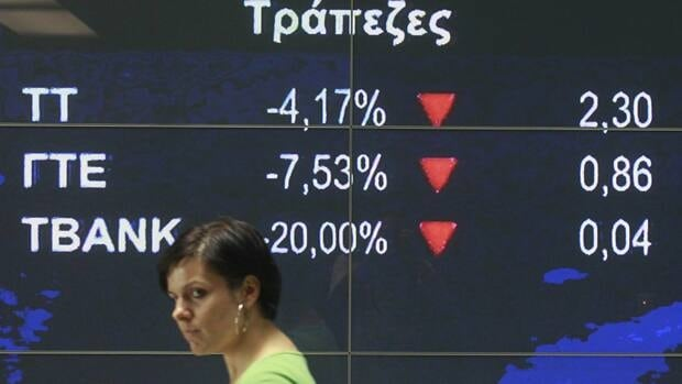 A screen at the Athens Stock Exchange shows falling bank shares on Thursday, July 14. Disagreement over the terms of a second rescue package rocked European markets for much of the week.