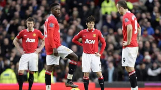 Manchester United's Ji-Sung Park, right-centre, stands amongst teammates after Blackburn Rovers' second goal on Saturday.