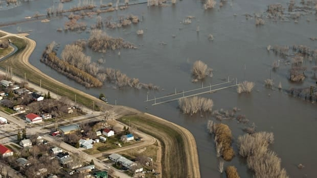 Flooding around Morris, Manitoba, shown on April 28. The Canadian Wheat Board says fields are so wet that only three per cent of grain has been sown, compared to the normal 40 per cent.