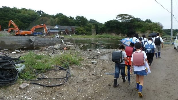 Where once there were houses on parts of Nonoshima Island, there is now only water and debris.