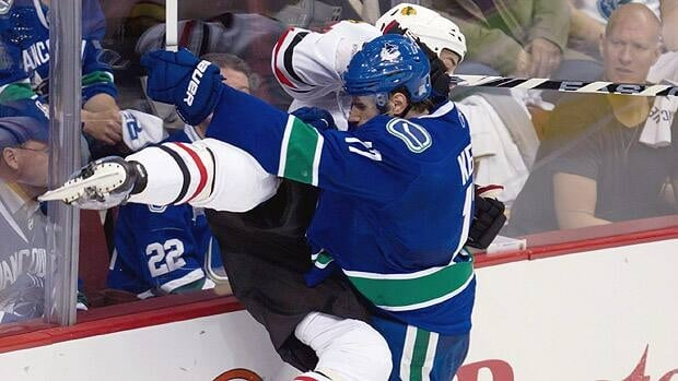 Vancouver forward Ryan Kesler drives Chicago defender Niklas Hjalmarsson into the boards the last time the clubs met at Rogers Arena, in Game 7 of the first round of the playoffs. Jonathan Hayward/Canadian Press
