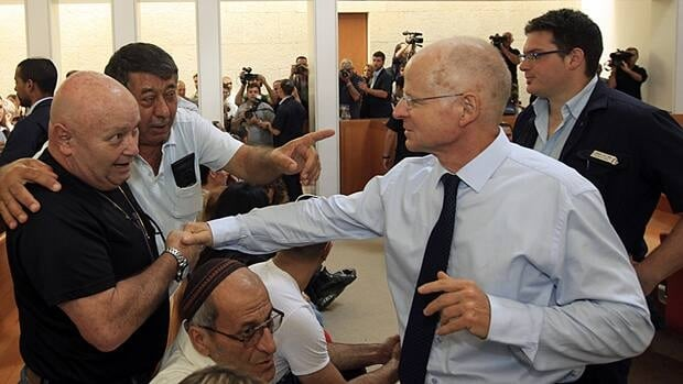 Noam Shalit, right, father of captive Israeli soldier Gilad Shalit, shakes hands with Zeev Rapp, father of Helena Rapp who was killed in a stabbing attack in 1992, at Israel's High Court in Jerusalem on Monday.