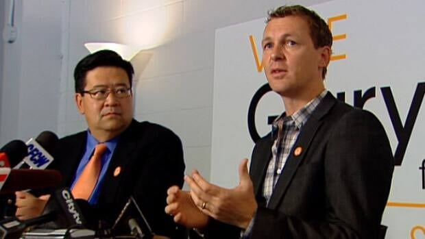 Doug Griffiths (right) speaks to reporters at a news conference about his support for Gary Mar in the Alberta Progressive Conservative leadership race.