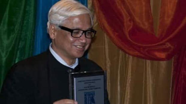 Amitav Ghosh accepst his Grand Prix from Montreal's Blue Met literary festival on Wednesday.