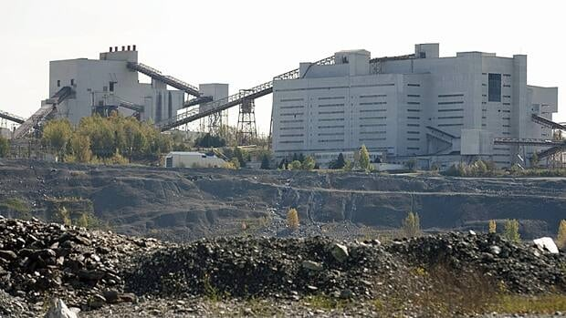 The Quebec government is expected to make a decision within weeks on whether to extend loan guarantees to investors to allow them to re-open the Jeffrey mine in Asbestos, Que.