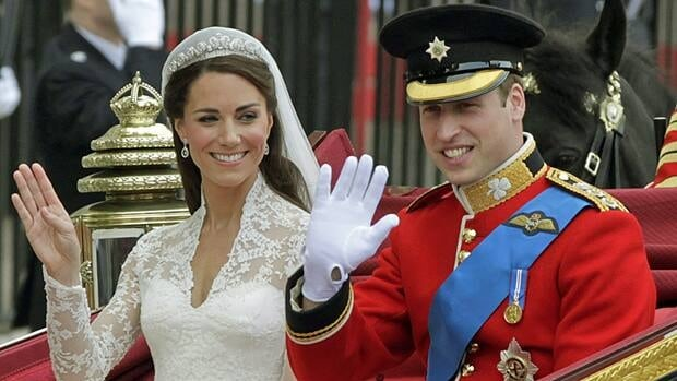 Kate Middleton tries out her new royal wave, and experienced royal Prince William waves too, as the happy newlyweds leave Westminster Abbey after their April 29 wedding ceremony. (