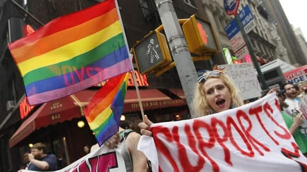 Gay rights advocates chant slogans during a rally for same sex marriage Thursday in New York.